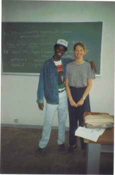 Sandra Rogers at chalk board with Mozambican student