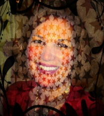 Photo of authur with stars, leaves, and vines over image.