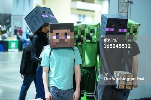 Students wearing decorated boxes on their heads and hip to  look like characters from the Minecraft video game