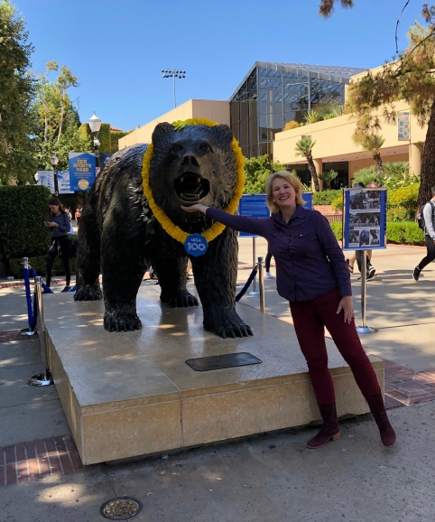 Sandra Rogers stands in front of the UCLA Bruin bear statue